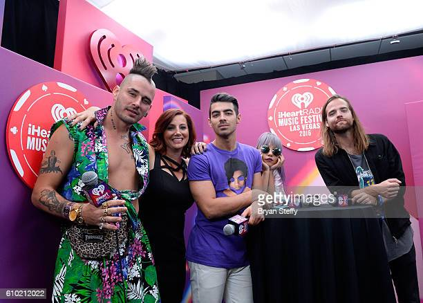 Radio personality Danielle Monaro poses with recording artists Cole Whittle Joe Jonas JinJoo Lee and Jack Lawless of music group DNCE at the 2016...