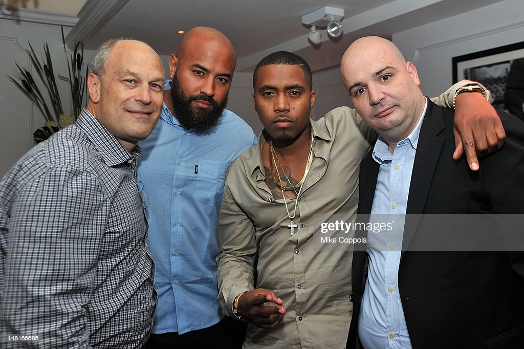 Radio personality Ebro Darden (2nd L), rapper Nas (2nd R), and president of Island Def Jam Joie Manda (R) attend Moet Rose Lounge Presents Nas' Life Is Good at Bagatelle on July 16, 2012 in New York City.