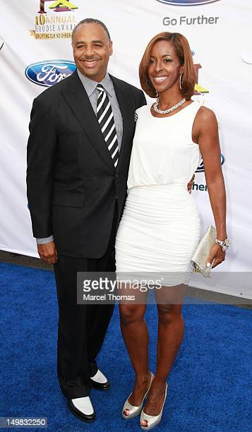 Radio personality Ed Gordon and wife Leslie Howard walk the blue carpet at the 10th Annual Ford Hoodie Awards at MGM Garden Arena on August 4 2012 in...