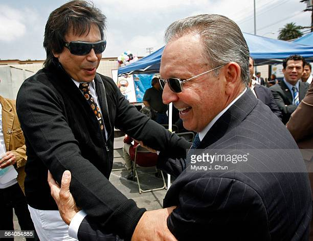 Radio personality El Cucuy left greets Enrique Alejo president CEO and founder of Liborio Markets during a press conference on Tuesday May 29 2007...