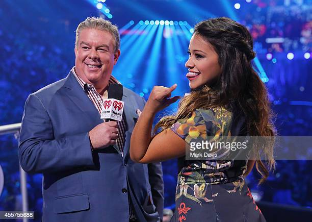 Radio personality Elvis Duran and actress Gina Rodriguez speak onstage during the 2014 iHeartRadio Music Festival at the MGM Grand Garden Arena on...
