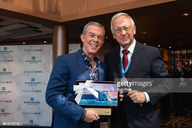 Radio Personality Elvis Duran and Godfather to Norwegian Bliss receives plaque from Bernard Meyer managing director of Meyer Werft on board Norwegian...