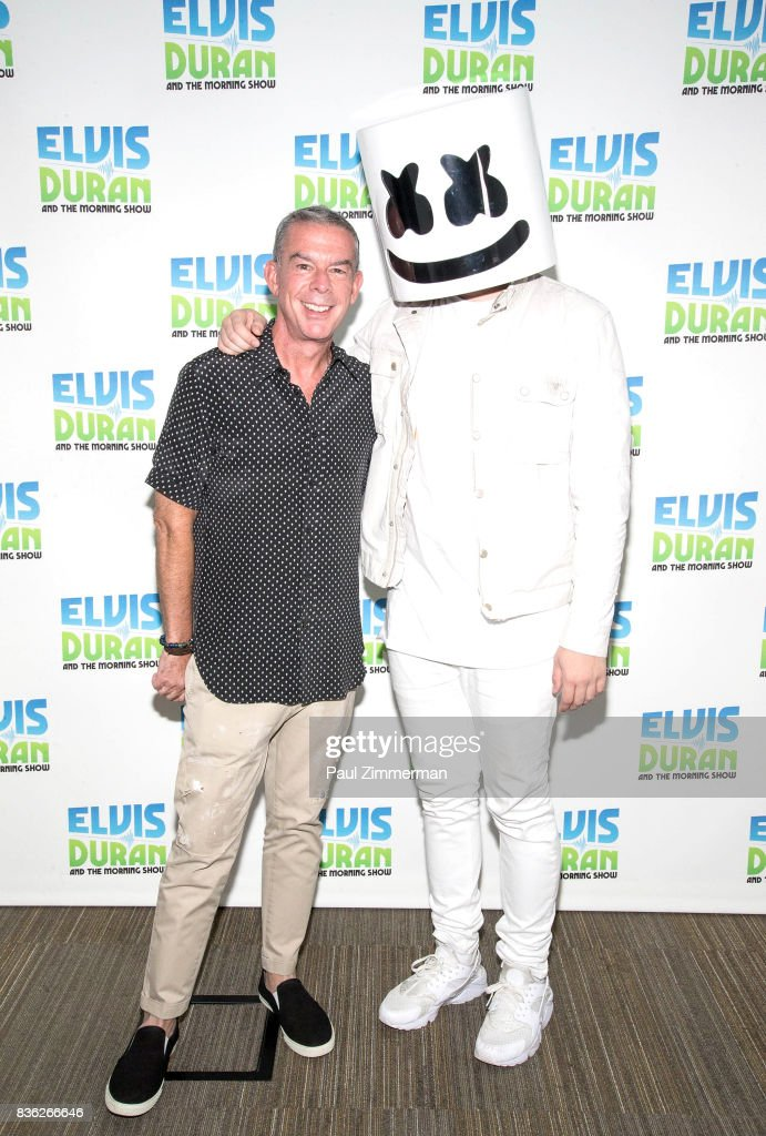 Radio personality Elvis Duran and Marshmello pose during 'The Elvis Duran Z100 Morning Show' at Z100 Studio on August 21, 2017 in New York City.