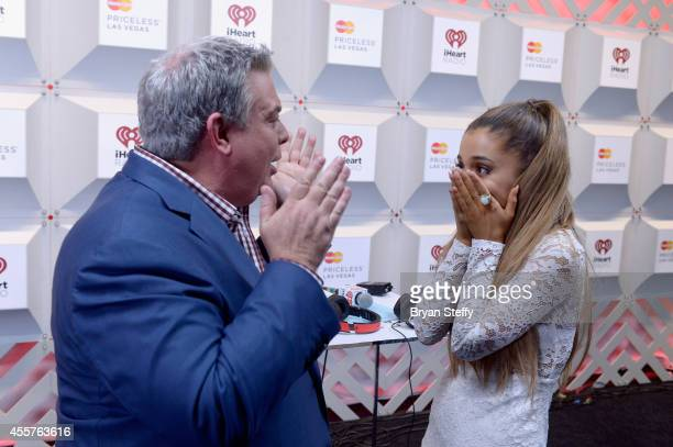Radio personality Elvis Duran and recording artist Ariana Grande attends the 2014 iHeartRadio Music Festival at the MGM Grand Garden Arena on...