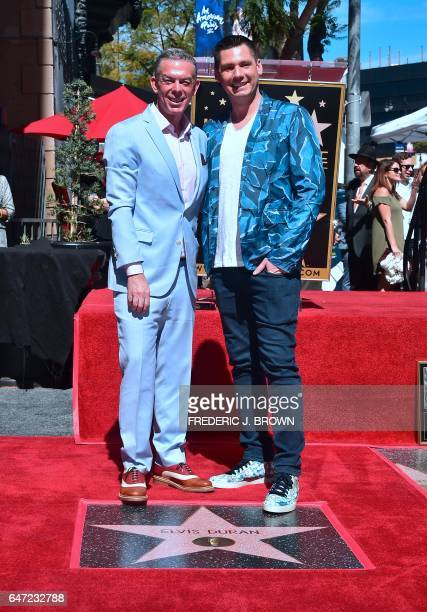 Radio personality Elvis Duran poses with Alex Carr on his Hollywood Walk of Fame ceremony in Hollywood California on March 2 2017 where he received...