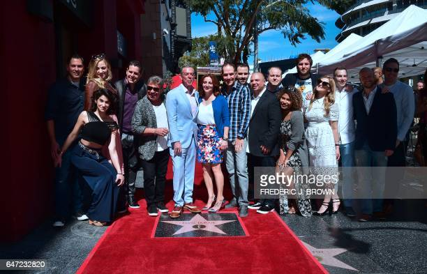 Radio personality Elvis Duran poses with cast from his Morning show on his Hollywood Walk of Fame ceremony in Hollywood California on March 2 2017...