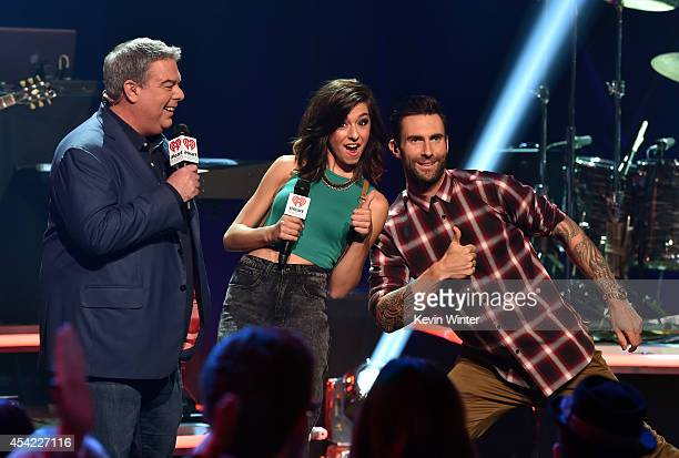 Radio personality Elvis Duran singers Christina Grimmie and Adam Levine speak onstage druing the iHeartRadio Album Release Party with Maroon 5 LIVE...