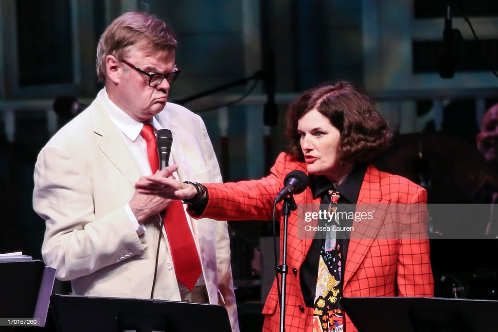 Radio personality Garrison Keillor (L) and comedienne Paula Poundstone perform during A Prairie Home Companion taping at The Greek Theatre on June 7, 2013 in Los Angeles, California.