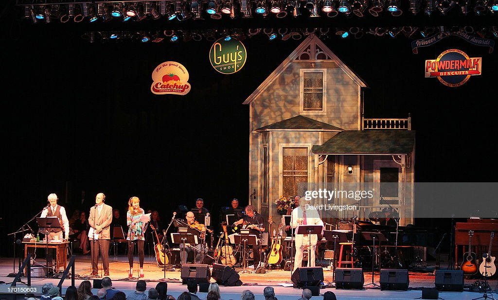 Radio personality Garrison Keillor (white suit) and members of A Prairie Home Companion perform on stage at the Greek Theatre on June 7, 2013 in Los Angeles, California.