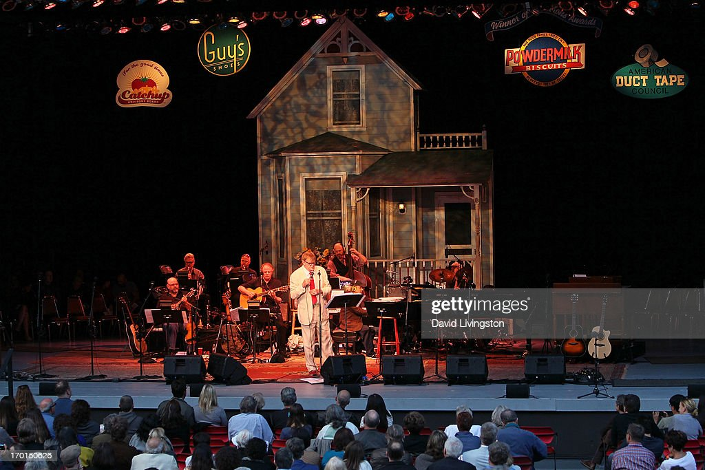 Radio personality Garrison Keillor (C) and members of A Prairie Home Companion perform on stage at the Greek Theatre on June 7, 2013 in Los Angeles, California.