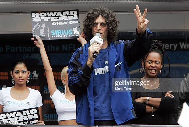 Radio personality Howard Stern hands out free satellite radios with Scores dancers in the background to thousands of fans in Union Square November 18...