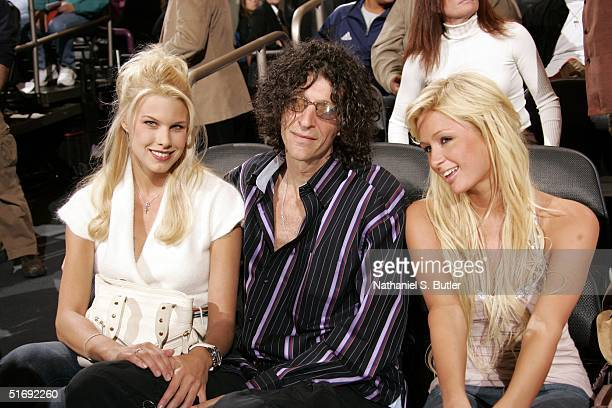 Radio personality Howard Stern with girlfriend Beth Ostrosky and model Paris Hilton attend the Boston Celtics versus the New York Knicks home opener...