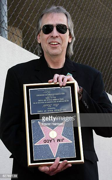 Radio personality Jim Ladd hold his star plaque upside down as a joke at his Hollywood Walk of Fame star ceremony on May 6 2005 in Hollywood...