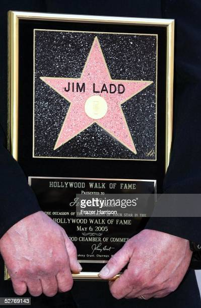 Radio personality Jim Ladd holds his star plaque on the Hollywood Walk of Fame on May 6 2005 in Hollywood California