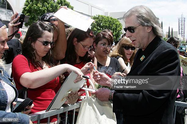 Radio personality Jim Ladd signs autographs after receiving his star on the Hollywood Walk of Fame on May 6 2005 in Hollywood California