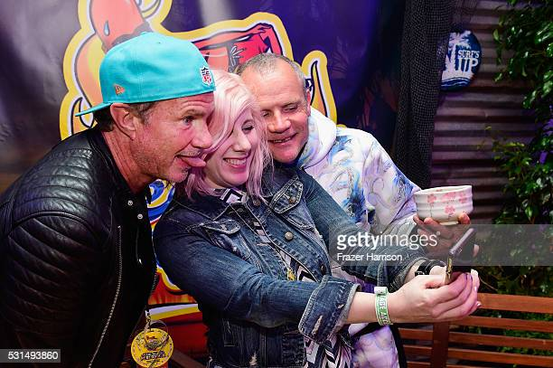 Radio personality Kat Corbett poses for a selfie photo with recording artists Chad Smith and Flea of music group Red Hot Chili Peppers at KROQ Weenie...