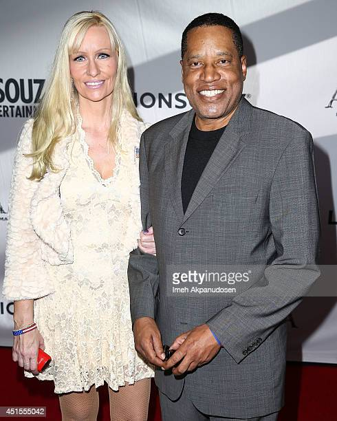 Radio personality Larry Elder and guest attend the premiere of Lionsgate Films' 'America' at Regal Cinemas LA Live on June 30 2014 in Los Angeles...