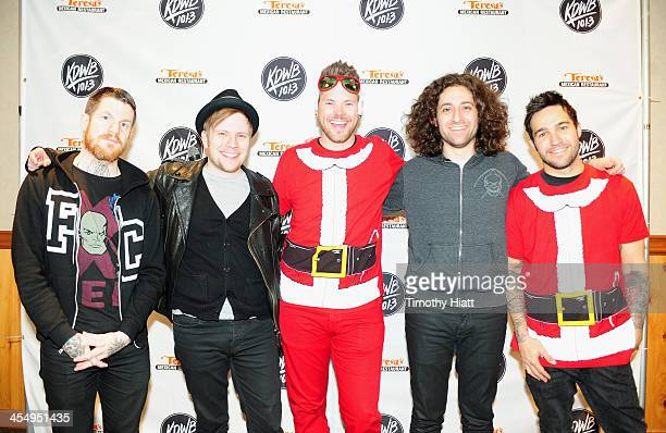 Radio personality Lucas Phelan poses with Andy Hurley, Patrick Stump, Joe Trohman, and Pete Wentz of Fall Out Boy backstage at 101.3 KDWB's Jingle...
