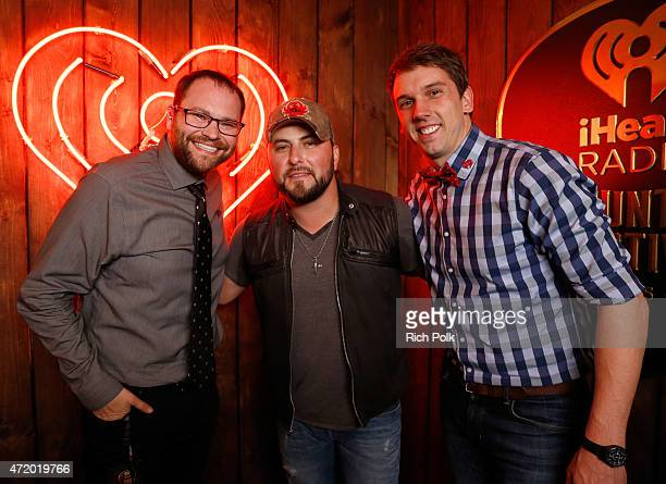 Radio personality Mason Singer Tyler Farr and radio personality Remy pose backstage during the 2015 iHeartRadio Country Festival at The Frank Erwin...