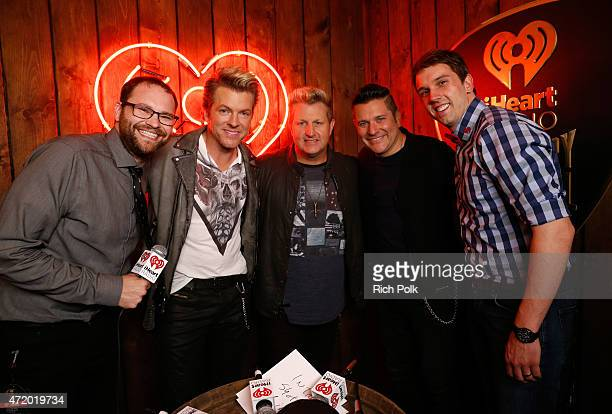 Radio personality Mason Singers JD Rooney Gary LeVox and Jay DeMarcus of Rascal Flatts and radio personality Remy pose backstage during the 2015...