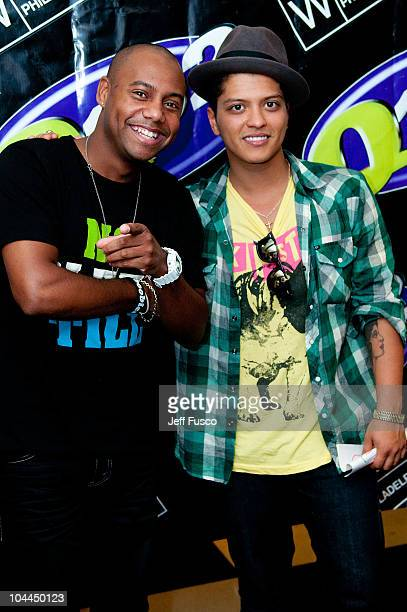Radio personality Maxwell and Bruno Mars pose at radio station Q102's Studio Q on September 25 2010 in Philadelphia Pennsylvania