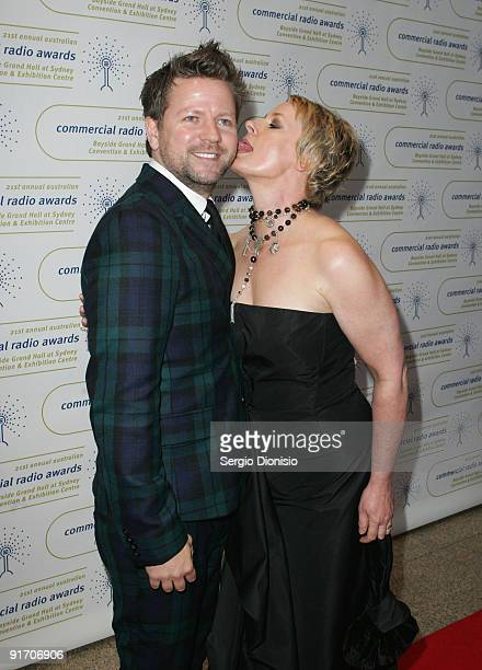 Radio personality Merrick Watts and Amanda Keller joke on the red carpet at the Australian Commercial Radio Awards 2009 at the Sydney Convention...