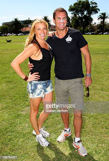Radio personality Mieke Buchan and former AFL player Wayne Carey of team The Vineyard pose prior to the 'Batting for the Battlers' Celebrity Charity...