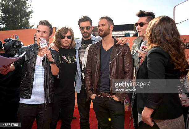 Radio personality Nathan Fast and musicians Chris Wood William Farquarson Kyle Simmons and Dan Smith of Bastille attend the 2014 iHeartRadio Music...