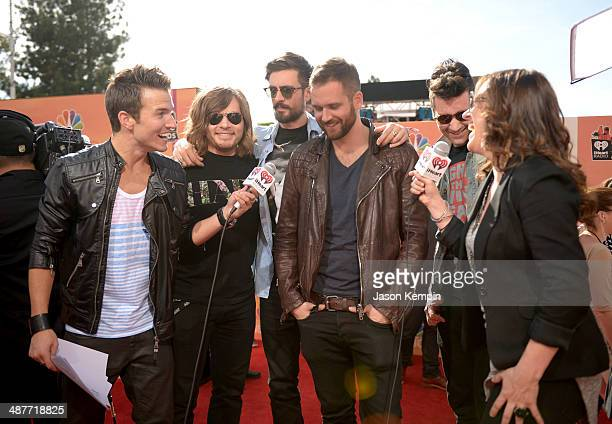 Radio personality Nathan Fast musicians Chris Wood William Farquarson Kyle Simmons and Dan Smith of Bastille and SIXX SENSE host Jenn Marino attend...