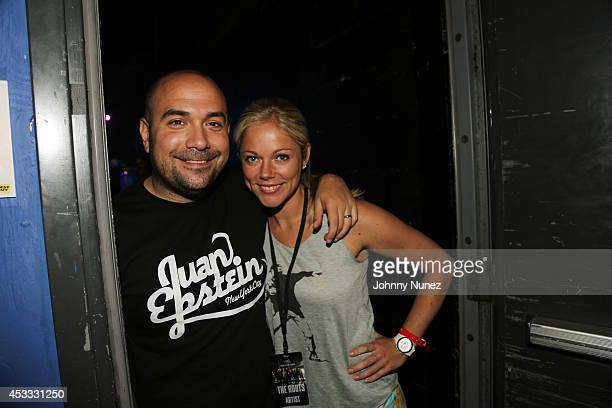 Radio personality Peter Rosenberg and wife Alexa Rosenberg attend the grand opening of the Guitar Center Times Square Flagship Store on August 7 2014...