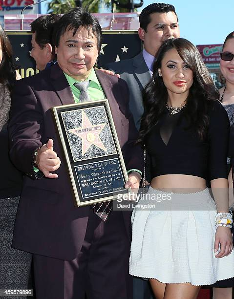Radio personality Renan Almendarez Coello aka El Cucuy de la Manana and actress Francia Raisa attend Coello being honored with a Star on the...