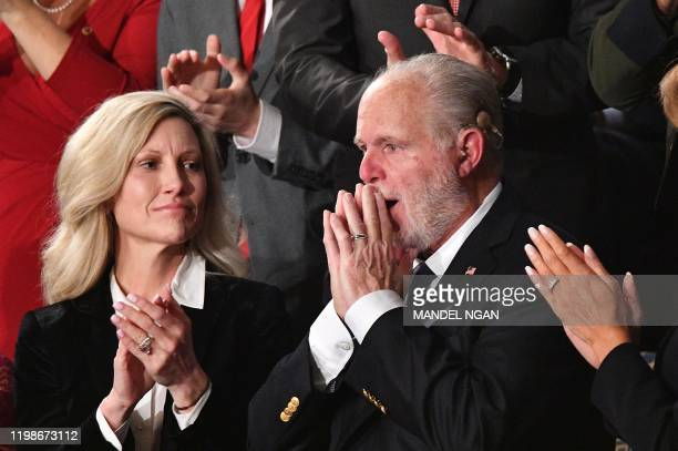 Radio personality Rush Limbaugh gestures after being awarded the Medal of Freedom by US President Donald Trump as he delivers the State of the Union...