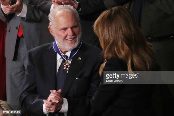 Radio personality Rush Limbaugh reacts after First Lady Melania Trump gives him the Presidential Medal of Freedom during the State of the Union...