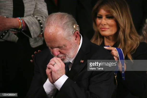 Radio personality Rush Limbaugh reacts as First Lady Melania Trump prepares to give him the Presidential Medal of Freedom during the State of the...