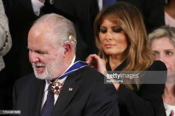 Radio personality Rush Limbaugh reacts as First Lady Melania Trump gives him the Presidential Medal of Freedom during the State of the Union address...
