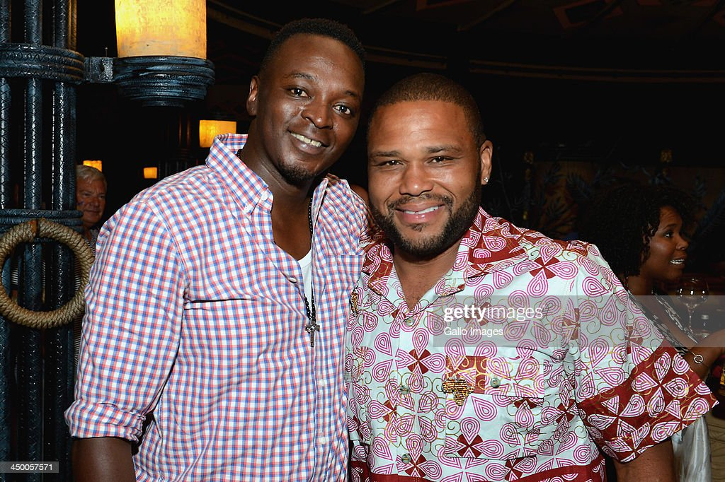Radio personality Thomas Msengena and actor Anthony Anderson (R) attend the official welcome function ahead of the Gary Player Invitational presented by Coca-Cola at The Palace Hotel and The Lost City Golf Course on November 14, 2013 in Sun City, South Africa.