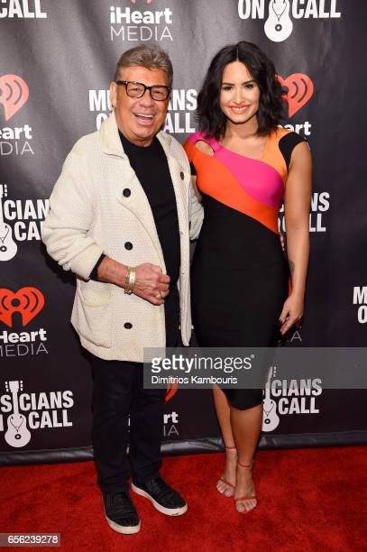 Radio Personality Uncle Johnny and Singer Demi Lovato attend A Night To Celebrate Elvis Duran presented by Musicians On Call at The Edison Ballroom...