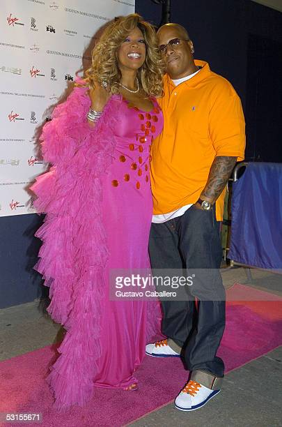 Radio Personality Wendy Williams and husband pose at the release party for Wendy Williams Brings The Heat Vol 1 at Quo on June 22 2005 in New York...
