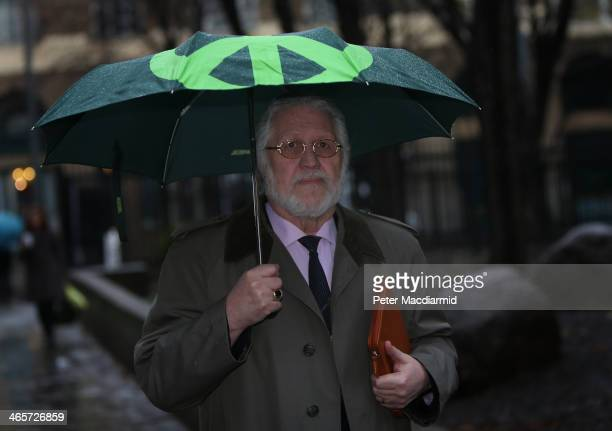Radio presenter Dave Lee Travis arrives at Southwark Crown Court on January 29 2014 in London England Dave Lee Travis whose real name is David...