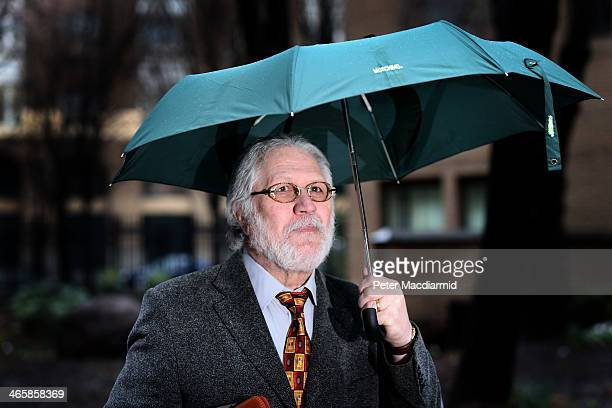 Radio presenter Dave Lee Travis arrives at Southwark Crown Court on January 30 2014 in London England Dave Lee Travis whose real name is David...