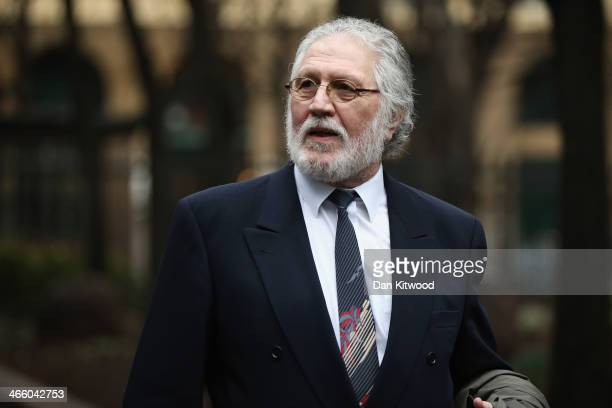 Radio presenter Dave Lee Travis arrives at Southwark Crown Court on January 31 2014 in Southwark England Dave Lee Travis whose real name is David...