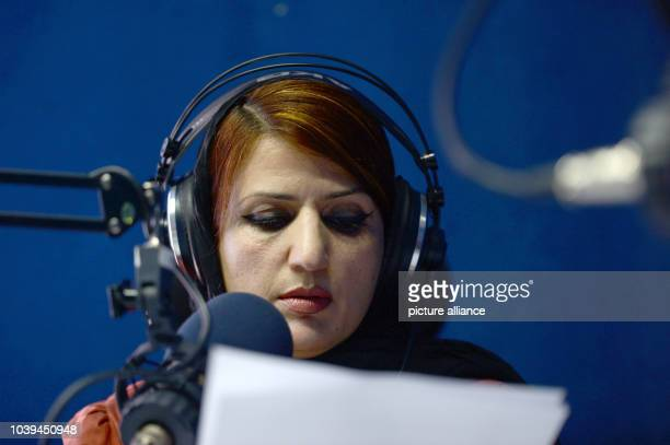 Radio presenter Hadia speaks into a microphone in the broadcast studio of of Afghan radion station Arman FM 981 in Kabul Afghanistan 14 April 2015...