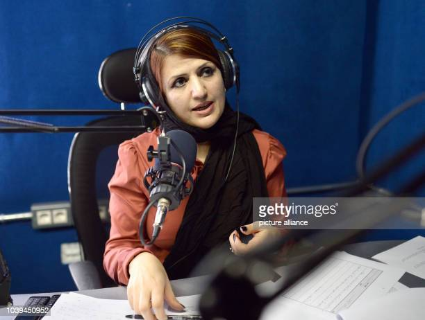 Radio presenter Hadia speaks into a microphone in the broadcasting studio of Afghan radion station Arman FM 981 in Kabul Afghanistan 14 April 2015...