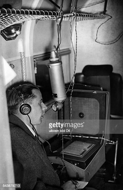 Radio presenter is informing about the traffic news from an aircraft Photographer Curt Ullmann Published by 'Hier Berlin' 41/1936Vintage property of...