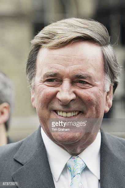 Radio presenter Terry Wogan awaits the arrival of Queen Elizabeth II outside the BBC Broadcasting House to mark the 80th anniversary of the granting...