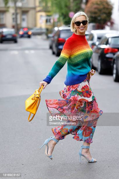 Radio presenter Verena Kerth, wearing multicolored stripedrainbow pullover by Elder Statesman, a multicolored skirt by Zimmermann, a yellow Hermes...