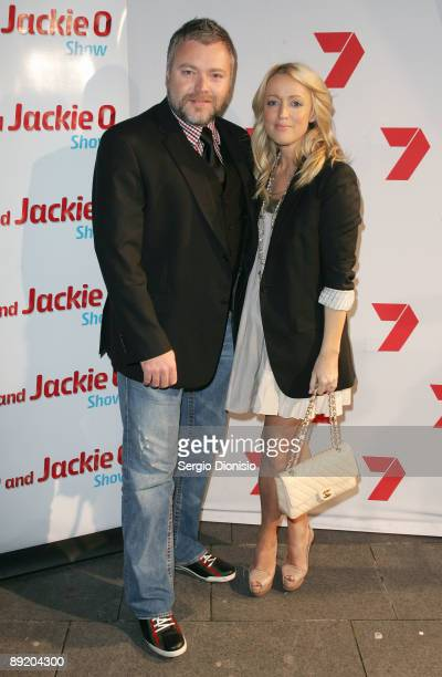 Radio presenters Kyle Sandilands and Jackie O arrives for the Home Away party at Cargo Bar on July 23 2009 in Sydney Australia