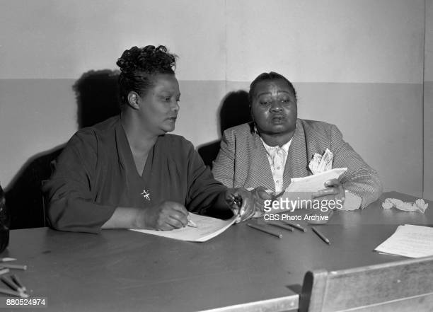Radio program The Beulah Show Pictured Ruby Dandridge portrays Oriole goes over script with Hattie McDaniel Hollywood CA Image dated July 8 1949