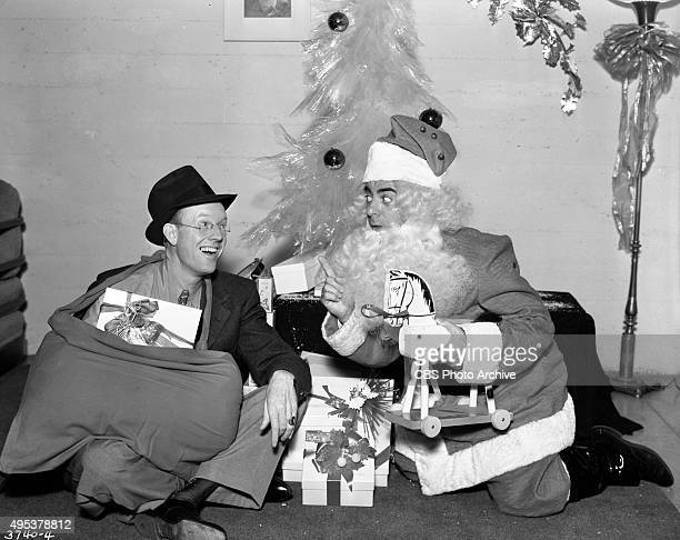 Radio program The Eddie Cantor Show sponsored by Texaco At Christmas time Eddie Cantor dresses up as Santa Claus with cast regular and singer...