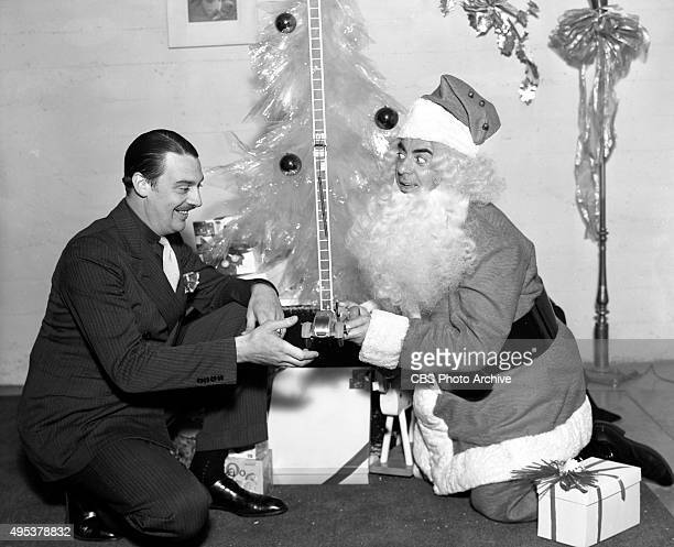 Radio program The Eddie Cantor Show sponsored by Texaco At Christmas time Eddie Cantor dresses up as Santa Claus with Radio announcer Jimmy...